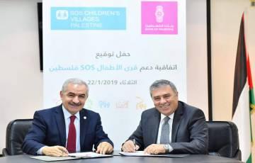 توقيع اتفاقية دعم لتمكين الأسرة بين بنك فلسطين ومنظمة قرى الأطفال العالمية