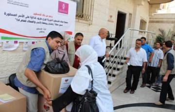 بدعم بنك فلسطين- عطاء فلسطين توزع موادا تموينية على الأسر المحتاجة